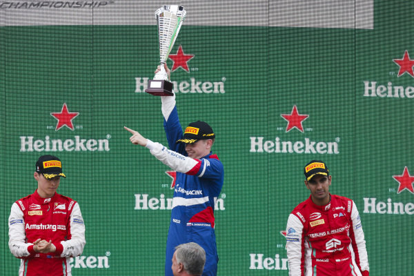 AUTODROMO NAZIONALE MONZA, ITALY - SEPTEMBER 07: Race winner Robert Shwartzman (RUS) PREMA Racing, Marcus Armstrong (NZL) PREMA Racing and Jehan Daruvala (IND) PREMA Racing celebrate on the podium during the Monza at Autodromo Nazionale Monza on September 07, 2019 in Autodromo Nazionale Monza, Italy. (Photo by Joe Portlock / LAT Images / FIA F3 Championship)