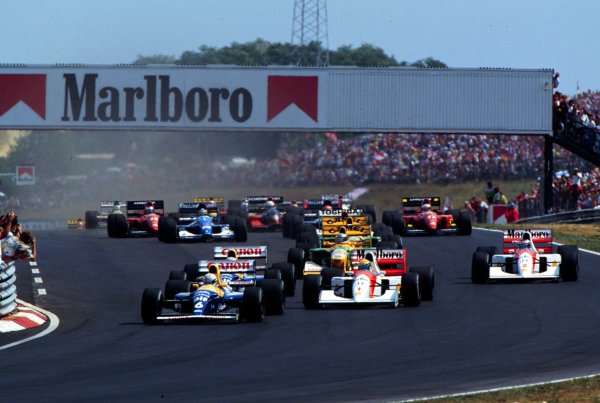 1992 Hungarian Grand Prix.Hungaroring, Budapest, Hungary.14-16 August 1992.Riccardo Patrese (Williams FW14B Renault) leads Ayrton Senna (McLaren MP4/7A Honda) and Nigel Mansell (Williams FW14B Renault). Senna finished in 1st position but Mansell clinched the World Championship.World - LAT Photographic