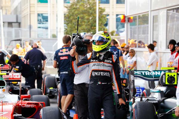 Baku City Circuit, Baku, Azerbaijan. Saturday 18 June 2016. Sergio Perez, Force India, celebrates his qualifying performance in parc ferme. World Copyright: Steven Tee/LAT Photographic ref: Digital Image _H7I9853
