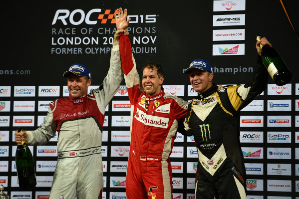 2015 Race Of Champions Olympic Stadium, London, UK Saturday 21 November 2015 Sebastian Vettel (GER) celebrates after winning the Race of Champions with Tom Kristensen (DMK) and Petter Solberg (NOR) Copyright Free FOR EDITORIAL USE ONLY. Mandatory Credit: 'IMP'
