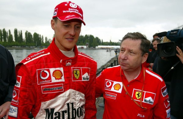 (L to R): Michael Schumacher (GER) Ferrari with Jean Todt (FRA) Ferrari General Manager.