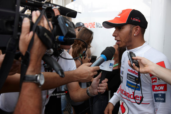 Interlagos, Sao Paulo, Brazil. 27th November 2011. Lewis Hamilton, McLaren MP4-26 Mercedes, retired, is interviewed after retiring from the race. Portrait. Media.  World Copyright: Steve Etherington/LAT Photographic ref: Digital Image SNE28265