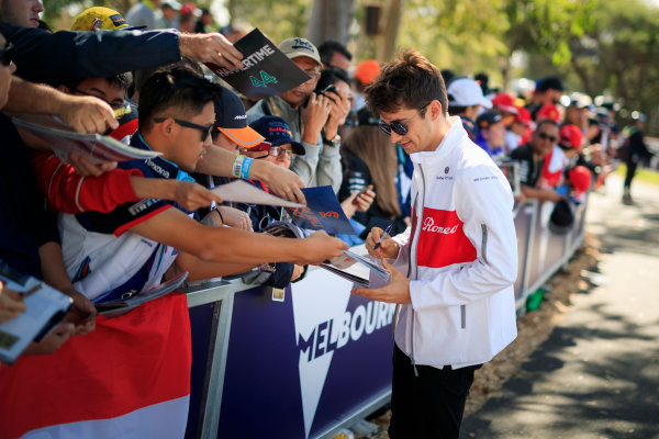 Charles Leclerc (MON) Alfa Romeo Sauber F1 Team signs autographs for the fans