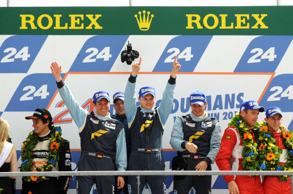 Circuit de La Sarthe, Le Mans, France. 6th - 13th June 2010.Marc Lieb / Richard Lietz / Wolf Henzler, Team Felbermayr-Proton, No 77 Porsche 911 GT3-RSR (997), GT2 winners. Portrait. Podium. World Copyright: Jeff Bloxham/LAT PhotographicDigital Image DSC_1779 JPG