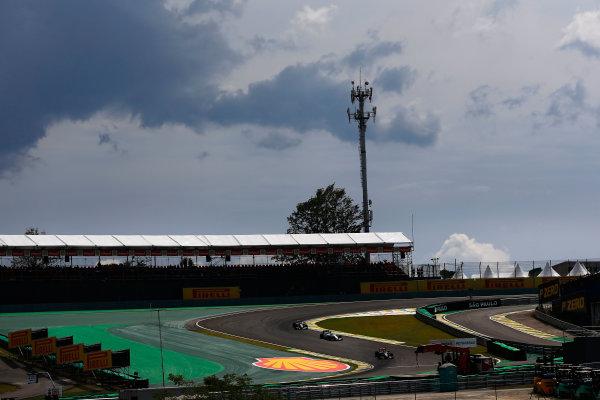Interlagos, Sao Paulo, Brazil. Friday 7 November 2014. Daniil Kvyat, Toro Rosso STR9 Renault, leads Felipe Massa, Williams FW36 Mercedes, and Jenson Button, McLaren MP4-29 Mercedes. World Copyright: Andrew Hone/LAT Photographic. ref: Digital Image _ONZ4870