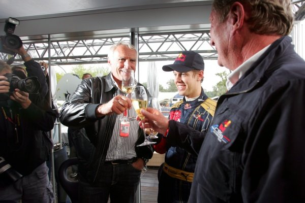 Sebastian Vettel (GER) Scuderia Toro Rosso celebrates victory with Dietrich Mateschitz (AUT) CEO and Founder of Red Bull and Dr Helmut Marko (AUT) Red Bull Motorsport Consultant.