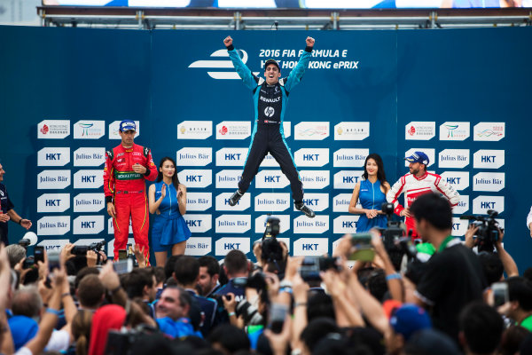 2016/2017 FIA Formula E Championship. Hong Kong ePrix, Hong Kong, China. Sunday 9 October 2016. Lucas Di Grassi (BRA), ABT Schaeffler Audi Sport, Spark-Abt Sportsline, ABT Schaeffler FE02, Sebastien Buemi (SUI), Renault e.Dams, Spark-Renault, Renault Z.E 16 and Nick Heidfeld (GER), Mahindra Racing, Spark-Mahindra, Mahindra M3ELECTRO on the podium. Photo: Andrew Ferraro/LAT/Formula E ref: Digital Image _FER2396