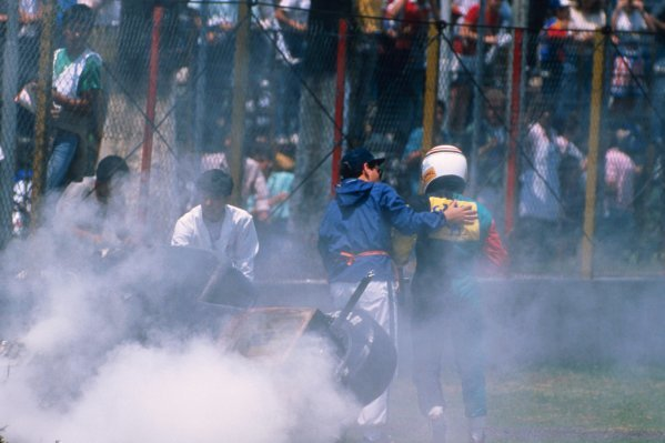 Philippe Alliot (FRA) walks away from the wreckage of his Larrousse Lola LC88 Ford. Mexican Grand Prix, Rd4, Mexico City, Mexico. 29th May 1988.