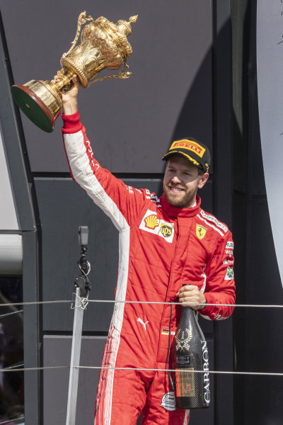 Sebastian Vettel (GER) Ferrari with the trophy and champagne