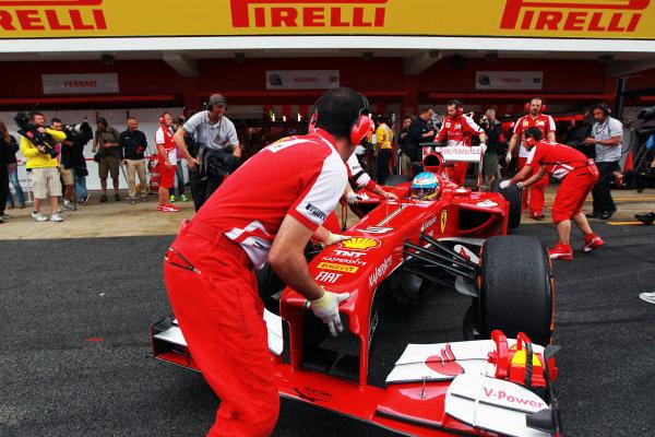 Circuit de Catalunya, Barcelona, Spain 10th May 2013 Fernando Alonso, Ferrari F138, is returned to the garage. World Copyright: Andy Hone/LAT Photographic ref: Digital Image HONY4720