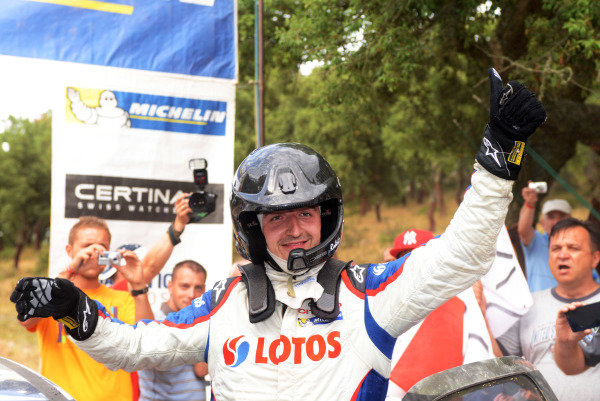 WRC2 winner Robert Kubica (POL), Citroen DS3 RRC, celebrates at the end of the final stage.