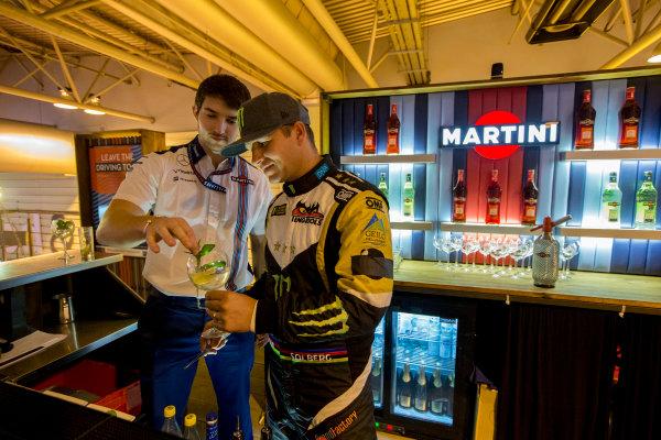 Autosport International Exhibition.  National Exhibition Centre, Birmingham, UK. Sunday 17 January 2016.  Petter Solberg learns how to mix Martini cocktails on the Williams motorhome. World Copyright: Zak Mauger/LAT Photographic. ref: Digital Image _L0U9429