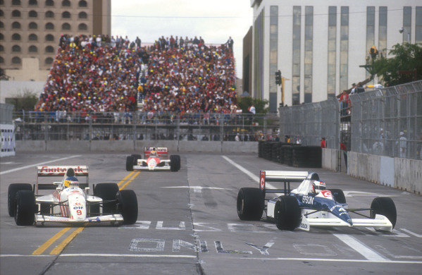 1990 United States Grand Prix.Phoenix, Arizona, USA.9-11 March 1990.Jean Alesi (Tyrrell 018 Ford) laps backmarker Michele Alboreto (Arrows A11B Ford) with Ayrton Senna (Mclaren MP4/5B Honda) still hot on his heels behind. They finished in 2nd and 1st positions respectively.Ref-90 USA 06.World Copyright - LAT Photographic