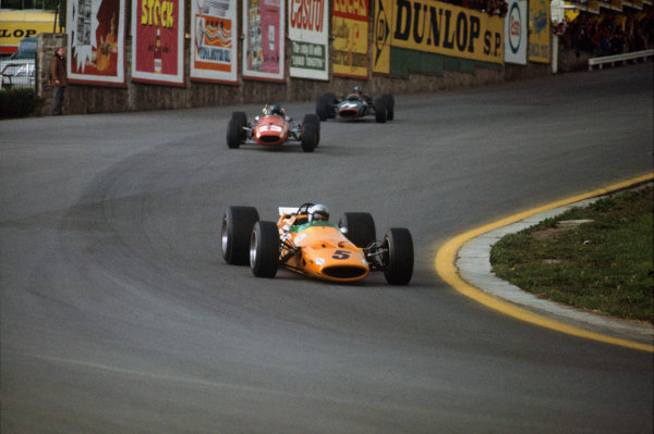Spa-Francorchamps, Belgium. 7-9 June 1968. Bruce McLaren (McLaren M7A Ford) leads Jacky Ickx (Ferrari 312) and Piers Courage (BRM P126). McLaren and Ickx finished in 1st and 3rd positions respectively. This was the McLaren constructors maiden Grand Prix win. Ref-68BEL06. World Copyright - LAT Photographic