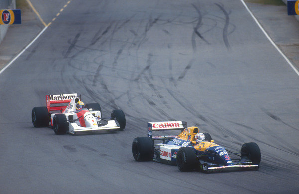 1992 Australian Grand Prix.Adelaide, Australia.6-8 November 1992.Nigel Mansell (Williams FW14B Renault) leads Ayrton Senna (McLaren MP4/7A Honda). They both exited the race whilst leading, when Senna hit Mansell from behind on lap 19.Ref-92 AUS 30.World Copyright - LAT Photographic