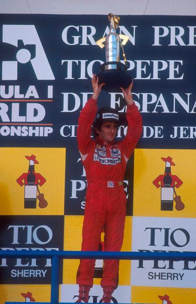 1988 Spanish Grand Prix.Jerez, Spain.30/9-2/10 1988.Alain Prost (McLaren Honda) 1st position on the podium. Ref-88 ESP 05.World Copyright - LAT Photographic