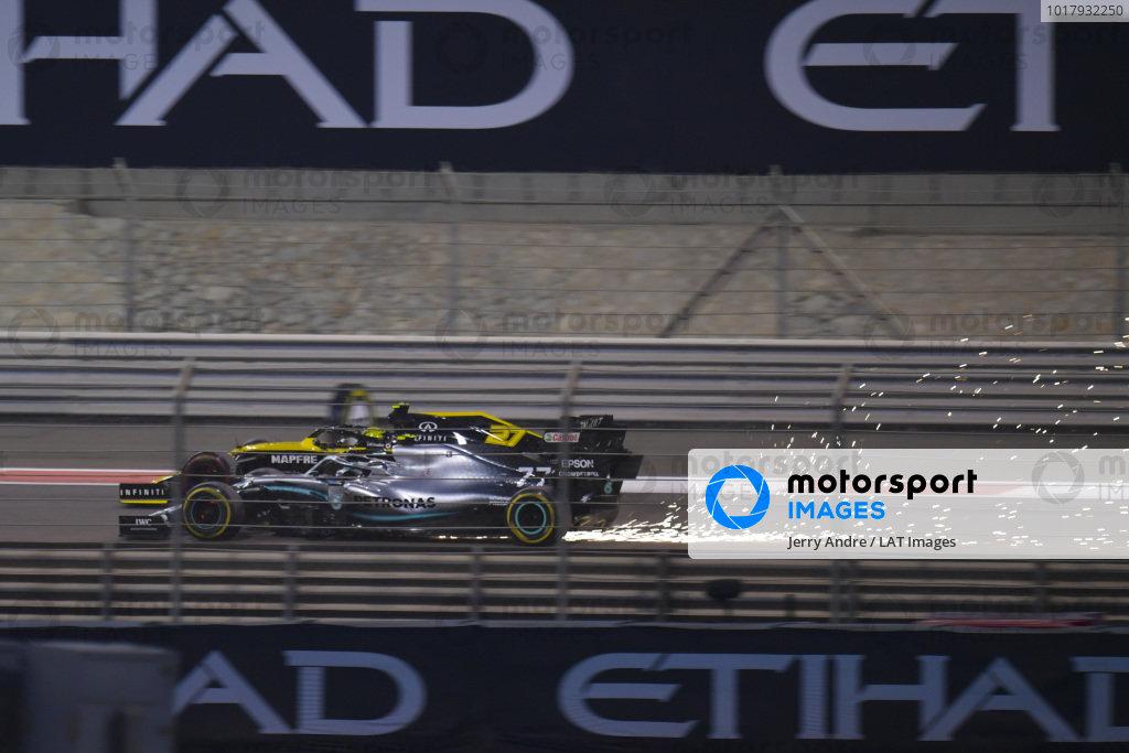 Nico Hulkenberg, Renault R.S. 19, leads a sparking Valtteri Bottas, Mercedes AMG W10