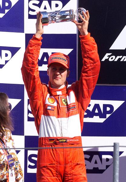 2001 American Grand Prix - RaceIndianapolis, United States. 30th September 2001.Michael Schumacher, Ferrari F2001, (2nd). Podium.World Copyright: Steve Etherington/LAT Photographicref: 18mb Digital Image