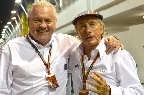 Alan Jones (AUS) and Jackie Stewart (GBR). Formula One World Championship, Rd14, Singapore Grand Prix, Marina Bay Street Circuit, Singapore, Practice, Friday 19 September 2014.