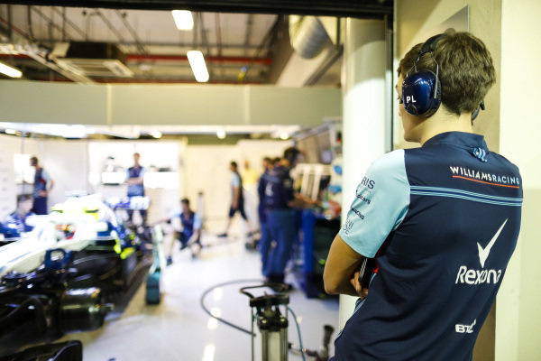 George Russell, Williams, watches team-mate Robert Kubica.