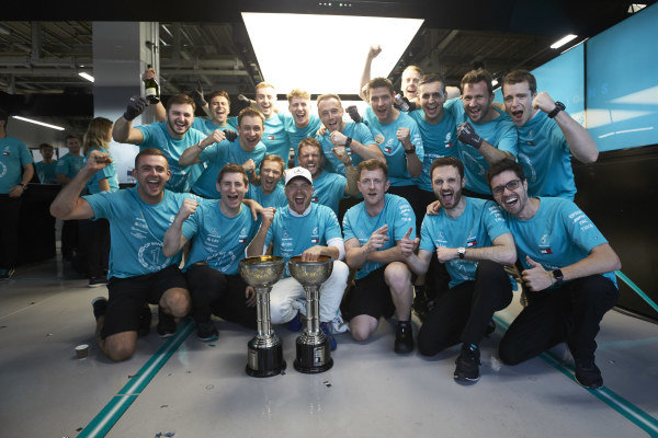 Valtteri Bottas, Mercedes AMG F1 joins other members of the AMG Mercedes F1 team celebrate winning the Constructors' World Championship