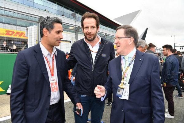 Shaikh Salman bin Isa Al Khalifa (BRN) Chief Executive of Bahrain International Circuit, Matteo Bonciani (ITA) FIA Media Delegate  and Lord Robertson (GBR) on the grid at Formula One World Championship, Rd10, British Grand Prix, Race, Silverstone, England, Sunday 16 July 2017.