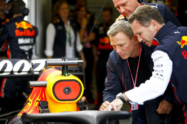 Daniel Craig, Actor withChristian Horner, Team Principal, Red Bull Racing in the Red Bull Racing Garage