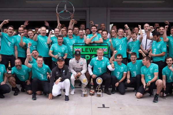 Sochi Autodrom, Sochi, Russia. Sunday 11 October 2015. Nico Rosberg, Mercedes AMG, Lewis Hamilton, Mercedes AMG, 1st Position, and the Mercedes team celebrate victory. World Copyright: Steve Etherington/LAT Photographic ref: Digital Image SNE21875