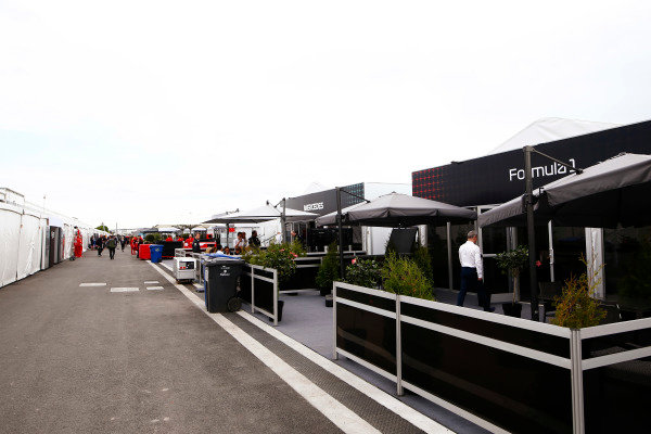 A view of makeshift hospitality units in the paddock.
