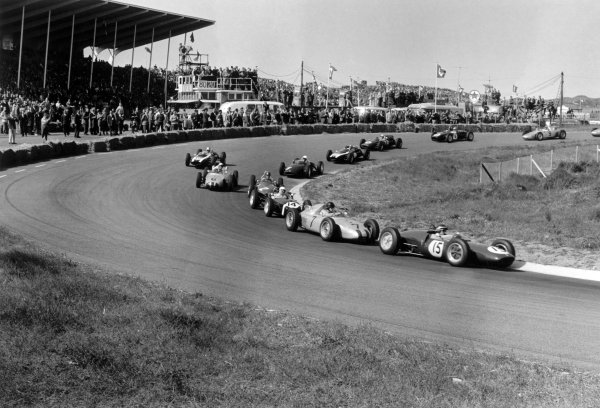 1961 Dutch Grand Prix Zandvoort, Holland. 20-22 May 1961 Jim Clark (Lotus 21-Climax) leads Dan Gurney (Porsche 787), Stirling Moss (Lotus 18-Climax), Richie Ginther (Ferrari Dino 156), Jo Bonnier (Porsche 787), Jack Brabham (#10 Cooper T55-Climax), Tony Brooks (#5 BRM P48/57-Climax), Bruce McLaren (Cooper T55-Climax), John Surtees (Cooper T53-Climax), Trevor Taylor (Lotus 18-Climax) and Hans Herrmann (Porsche 718) .World Copyright: LAT PhotographicRef: Autosport b&w print