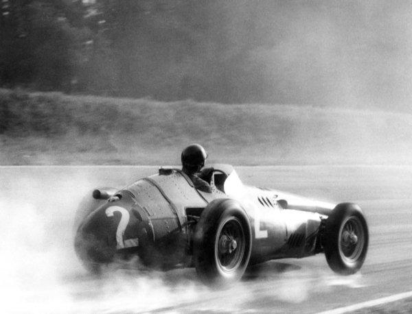1957 Italian Grand Prix.Monza, Italy. 8 September 1957.Juan Manuel Fangio (Maserati 250F), 2nd position.World Copyright: LAT Photographicref: B&W Print (60mb Scan).
