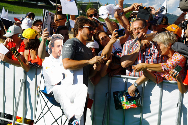 Red Bull Ring, Spielberg, Austria. Thursday 06 July 2017. Fernando Alonso, McLaren, signs autographs for fans next to his cardboard cutout. World Copyright: Steven Tee/LAT Images ref: Digital Image _O3I4639