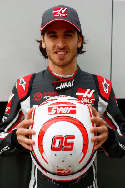 Silverstone, Northamptonshire, UK.  Thursday 13 July 2017. Antonio Giovinazzi, Haas test driver, holds up his crash helmet. World Copyright: Andy Hone/LAT Images  ref: Digital Image _ONZ2869