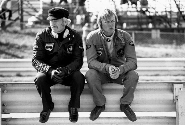 Watkins Glen, New York, USA. 4 - 6 October 1974.Ronnie Peterson (Lotus 72E-Ford), retired, sits on the armco barrier with team boss Colin Chapman after hearing the death of Helmuth Koinigg, portrait. World Copyright: LAT Photographic.Ref:  6870 - 21.
