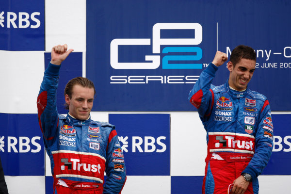 Magny-Cours, France. 22nd June.Sunday Race. Sebastien Buemi (SUI, Trust Team Arden) celebrates victory on the podium with Yelmer Buurman (NED, Trust Team Arden). World Copyright: Andrew Ferraro/GP2 Series Media Service.ref: Digital Image _H0Y8061