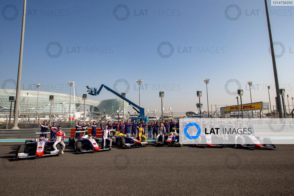 2016 GP2 Series Round 11. Yas Marina Circuit, Abu Dhabi, United Arab Emirates. Thursday 24 November 2016. Trident team photo with GP2 and GP3 drivers Philo Paz Armand (INA, Trident), Luca Ghiotto (ITA, Trident), Antonio Fuoco (ITA, Trident), Artur Janosz (POL, Trident), Giuliano Alesi (FRA, Trident) and Sandy Stuvik (THA, Trident). Photo: Zak Mauger/GP2 Series Media Service. ref: Digital Image _X0W7267