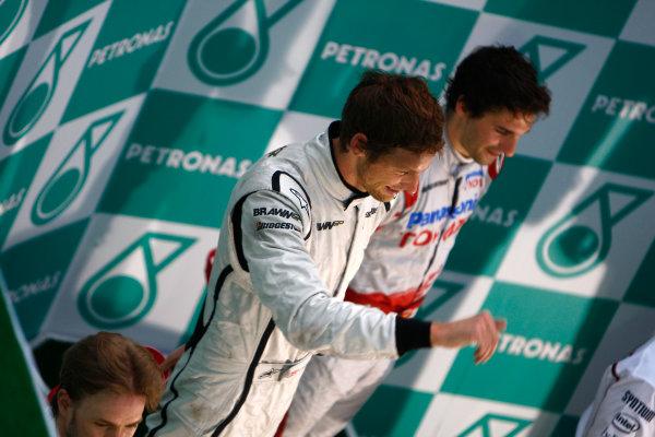 Sepang, Kuala Lumpur, Malaysia5th April 2009Jenson Button, Brawn GP BGP001 Mercedes celebrates on the podium.World Copyright: Steven Tee/LAT Photographicref: Digital Image _95U0121
