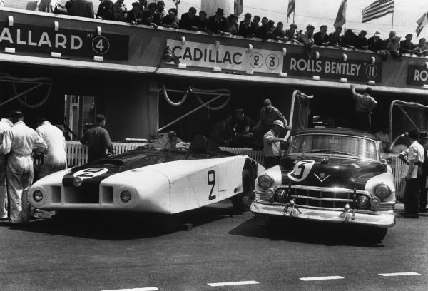 """Le Mans, France. 24th - 25th June 1950 Briggs Cunningham/Phil Walters (Cadillac Spider """"Le Monstre""""), 11th position and Miles Collier/Sam Collier (Cadillac Coupe de Ville), 10th position, in the pit lane before the start, action. World Copyright: LAT Photographic Ref: L466 -13A."""