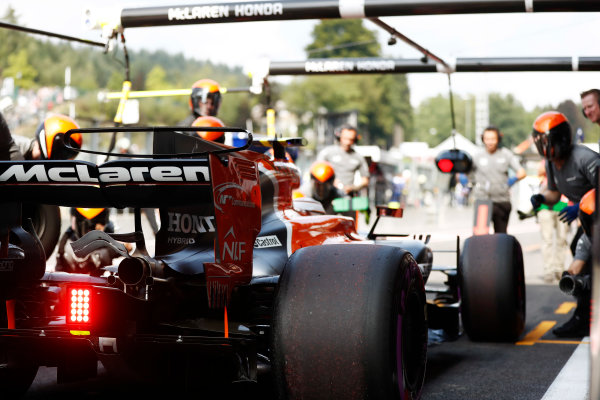 Spa Francorchamps, Belgium.  Saturday 26 August 2017. Stoffel Vandoorne, McLaren MCL32 Honda, makes a practice pit stop. World Copyright: Glenn Dunbar/LAT Images  ref: Digital Image _X4I5946