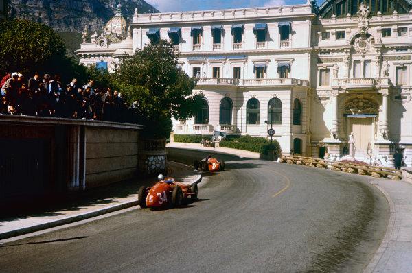 Monte Carlo, Monaco. 16-19 May 1957. Masten Gregory leads Giorgio Scarlatti (both Maserati 250F) heading towards the casino. Gregory finished in 3rd position. Ref: 57MON20. World Copyright - LAT Photographic