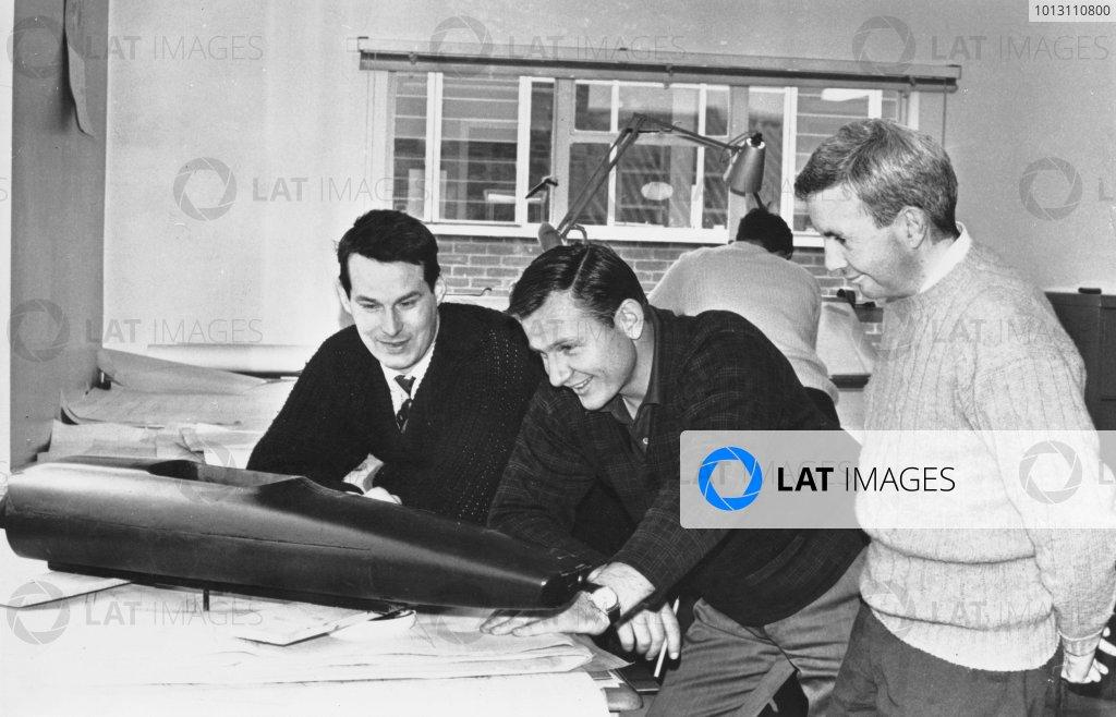 1968 Team McLaren Factory.Woking, Surrey. 6th June 1968.Robin Herd, Chief Designer, talks with owner Bruce McLaren and Teddy Mayer, portrait.World Copyright: LAT Photographic.ref: B/W Print.