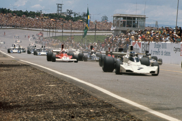 1974 Brazilian Grand Prix  Interlagos, Sao Paulo, Brazil. 25-27th January 1974.  Cars leave the grid at the start including Carlos Reutemann, Brabham BT44 Ford, Clay Regazzoni, Ferrari 312B3, Peter Revson, Shadow DN3 Ford, and Jacky Ickx, Lotus 72E Ford.  Ref: 74BRA02. World Copyright: LAT Photographic