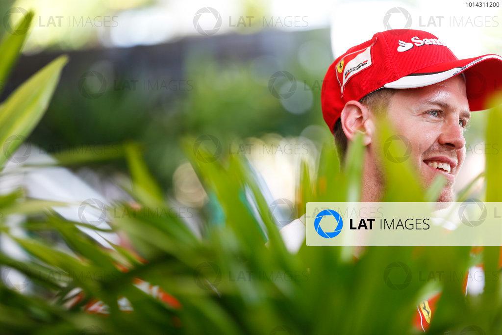 Sepang International Circuit, Sepang, Kuala Lumpur, Malaysia. Thursday 26 March 2015. Sebastian Vettel, Ferrari, in the Paddock. World Copyright: Charles Coates/LAT Photographic. ref: Digital Image _N7T2863