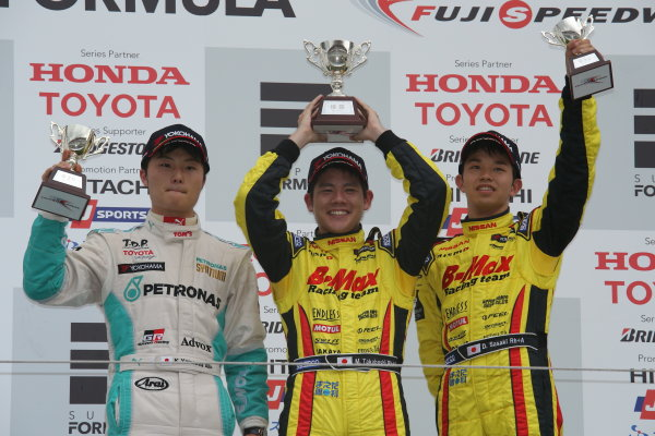 2014 All-Japan F3 Championship. Fuji, Japan. 11th - 13th July 2014. Rd 4. Race 1 - Winner Mitsunori Takaboshi ( #22 B-MAX Racing Team with NDDP ) 2nd position Kenta Yamashita ( #36 PETRONAS TEAM TOM'S ) 3rd position Daiki Sasaki ( #23 B-MAX Racing Team with NDDP ) podium, portrait. World Copyright: Yasushi Ishihara / LAT Photographic. Ref: 2014JF3_Rd8&9_008.JPG