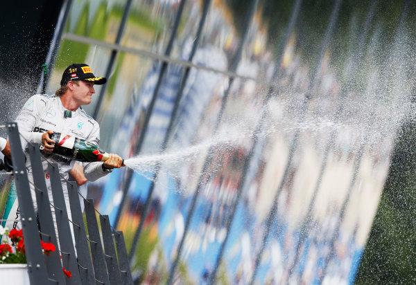 Red Bull Ring, Spielberg, Austria. Sunday 22 June 2014. Nico Rosberg, Mercedes AMG, 1st Position, celebrates on the podium. World Copyright: Steven Tee/LAT Photographic. ref: Digital Image _X0W0910