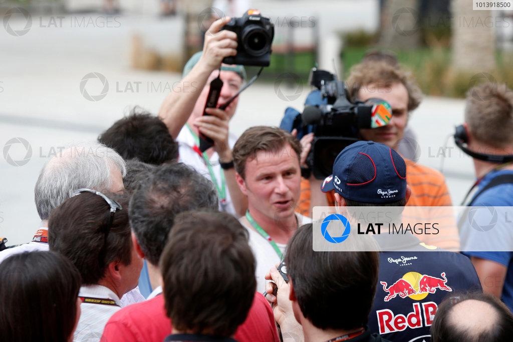 Bahrain International Circuit, Sakhir, Bahrain Thursday 18th April 2013 Mark Webber, Red Bull Racing, is interviewed. World Copyright: Charles Coates/LAT Photographic ref: Digital Image _N7T8834