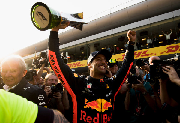 Daniel Ricciardo, Red Bull Racing, 1st position, and the Red Bull team celebrate victory.
