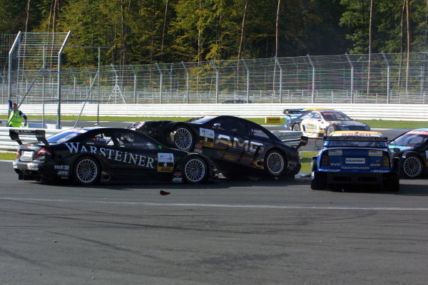Jean Alesi (FRA), AMG-Mercedes CLK,  lands on top of Marcel Fassler (CZH), Warsteiner AMG-Mercedes CLK,  after driving into Alain Menu (FRA), Opel Euroteam Astra Coupe, at the new hairpin corner.