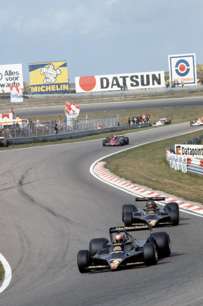 Zandvoort, Holland. 25-27 August 1978. Mario Andretti (Lotus 79-Ford), 1st position, leads Ronnie Peterson (Lotus 79-Ford), 2nd position, action.  World Copyright: LAT Photographic. Ref: 78HOL27