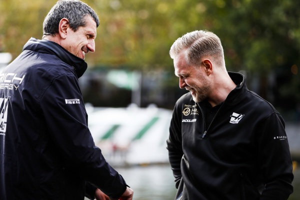 Guenther Steiner, Team Principal, Haas F1 and Kevin Magnussen, Haas F1 Team on the way to the Federation Square event.